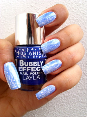 Bubbly Effect    turn your nails into a thousand coloured bubbles. Bubbly effect is the lastest craze mimicking marbled nails.  By layering the bubbly effect colour over any nail polish colour...the possibilities are endless!  Choose from 5 fashionable colours White, Cherry, Blue, Black  and Red.  Accent Nails $5.00 per nail or Additional $15.00 with any nail service